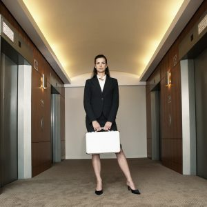 Businesswoman Waiting for Elevator